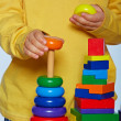 Boy playing with pyramid — Stock Photo #11477337