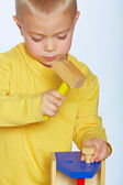 Boy with toy hammer — Stock Photo