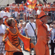 Stock Photo: Unidentified Dutch fans in flamboyant costumes