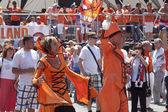 Unidentified Dutch fans in a flamboyant costumes — Stock Photo