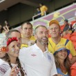 England fan between the Ukrainian fans - Stock Photo