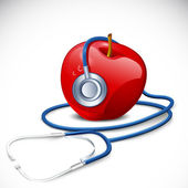 Stethoscope on Apple — Stock Photo