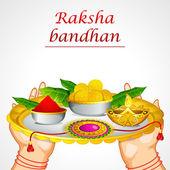 Raksha bandhan thali tutan el — Stok Vektör
