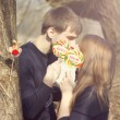 Young couple having covered candy kisses — Stock Photo