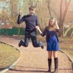 Happy jumping pair — Stock Photo #11138870