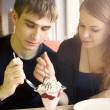 Closeup portrait of young cute couple at cafe — Stock Photo