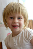 Little girl smiles at the camera — Stock Photo