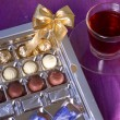 Holiday box of chocolates next cup of tea — Stock Photo