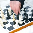 Man's hand over the chess board — Stock Photo