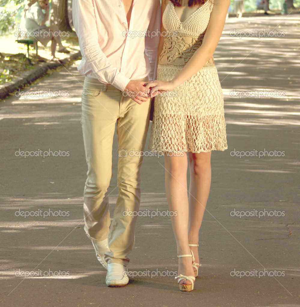 Portrait of romantic young couple walking on path in park - Outdoor  Stock Photo #12158253