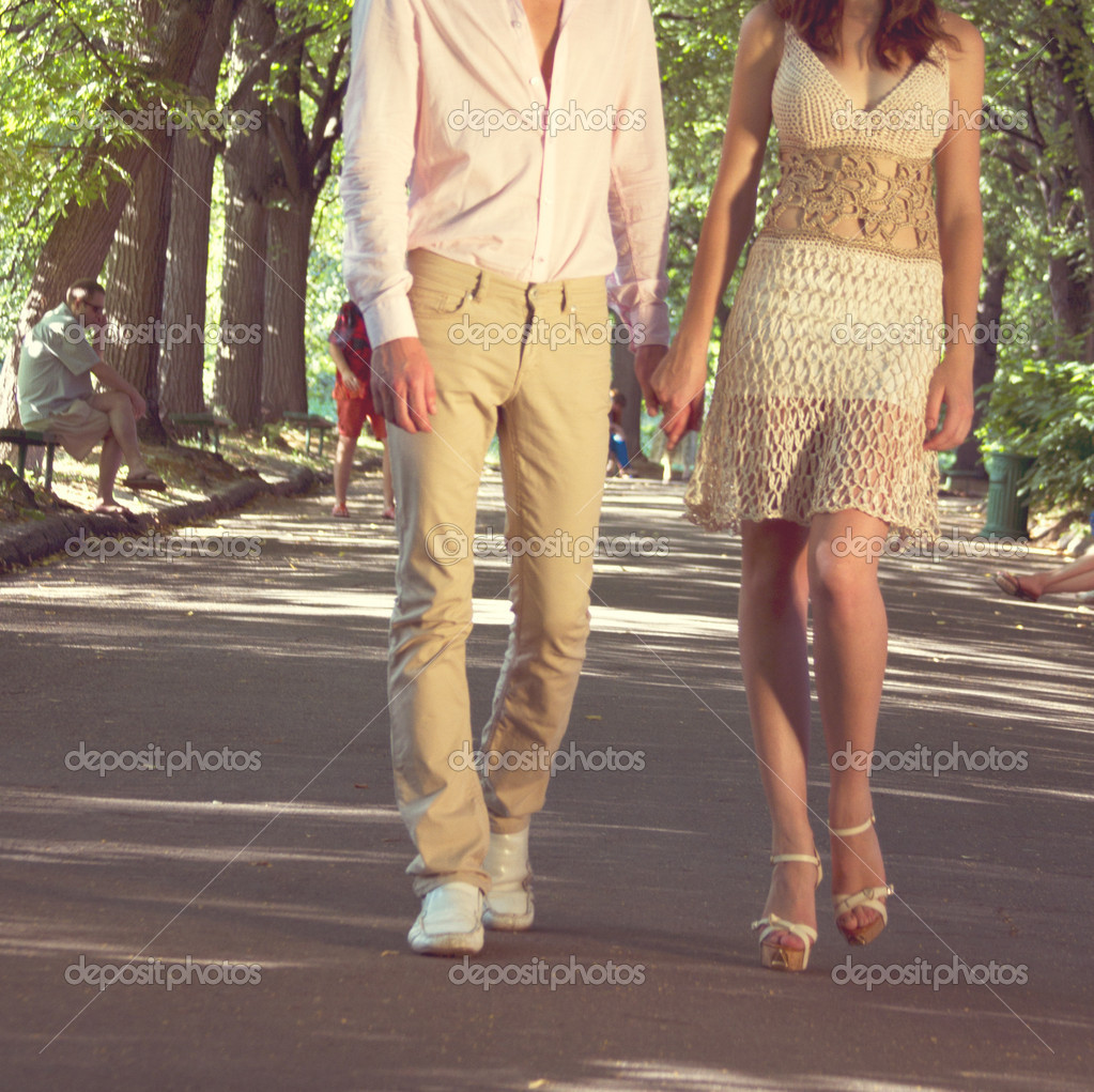 Portrait of romantic young couple walking on path in park - Outdoor — Stock Photo #12158281