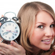 Beautiful woman with aralm clock — Stock Photo