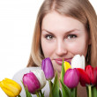Stock Photo: Beauty womwith tulips