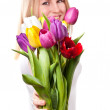 Young woman with tulips — Stock Photo