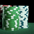 Poker chips on green table — Stock fotografie