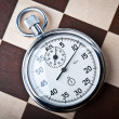 Foto de Stock  : Stopwatch and chessboard