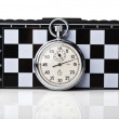 Stopwatch and chessboard — Stockfoto