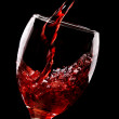 Red wine pouring into glass — Stock Photo #12059681