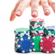 Man's hand reaches out to the poker chips — Stock Photo