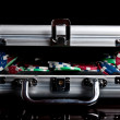 Poker chips in a suitcase — Stock Photo