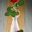 Red rose in white vase — Stock Photo