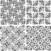 Set of 4 seamless patterns. Monochrome geometrical patterns — Stock Vector