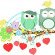 Two cute owls and bird on the flower tree branch - Stockvectorbeeld
