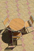Table and chair on the street — ストック写真