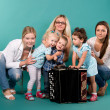 Group of young moms with children — Stock Photo #11090221
