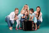 Group of young moms with children — Stock Photo