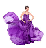 Girl in flying purple silk dress — Stock Photo