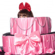 Girl, a surprise gift, looks out a toy cake — Foto Stock