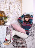 Girl winter clothes in a cozy interior — Stok fotoğraf