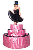 Girl, a surprise gift, jumps out of the toy cake — Stock Photo