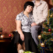 Portrait couple in room with vintage retro wallpaper — Stock Photo #11779845