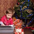 Boy prints letter to Santa on a typewriter — Stock Photo