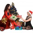 Girls give each other gifts for the new year — Stock Photo #11779904