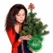 Stok fotoğraf: Beautiful girl is considering jewels on tree