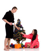 Couple drinking coffee in the bath robes around dressed Christma — Stock Photo