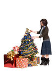 Beautiful girl with curly hair, dress up a Christmas tree — Stock Photo