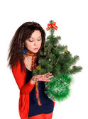 Beautiful girl is considering jewels on the tree — Stock Photo