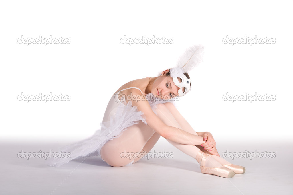 Ballet dancer in a white skirt and a carnival mask. in studio — Stock Photo #12125641