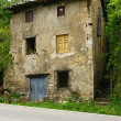 Stock Photo: House in ruinous condition in Cercs
