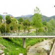 Route with lampposts and bridge of Cercs's Park — Stock Photo