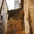 Alley with belfry to the fund of El Arbós — Stock Photo