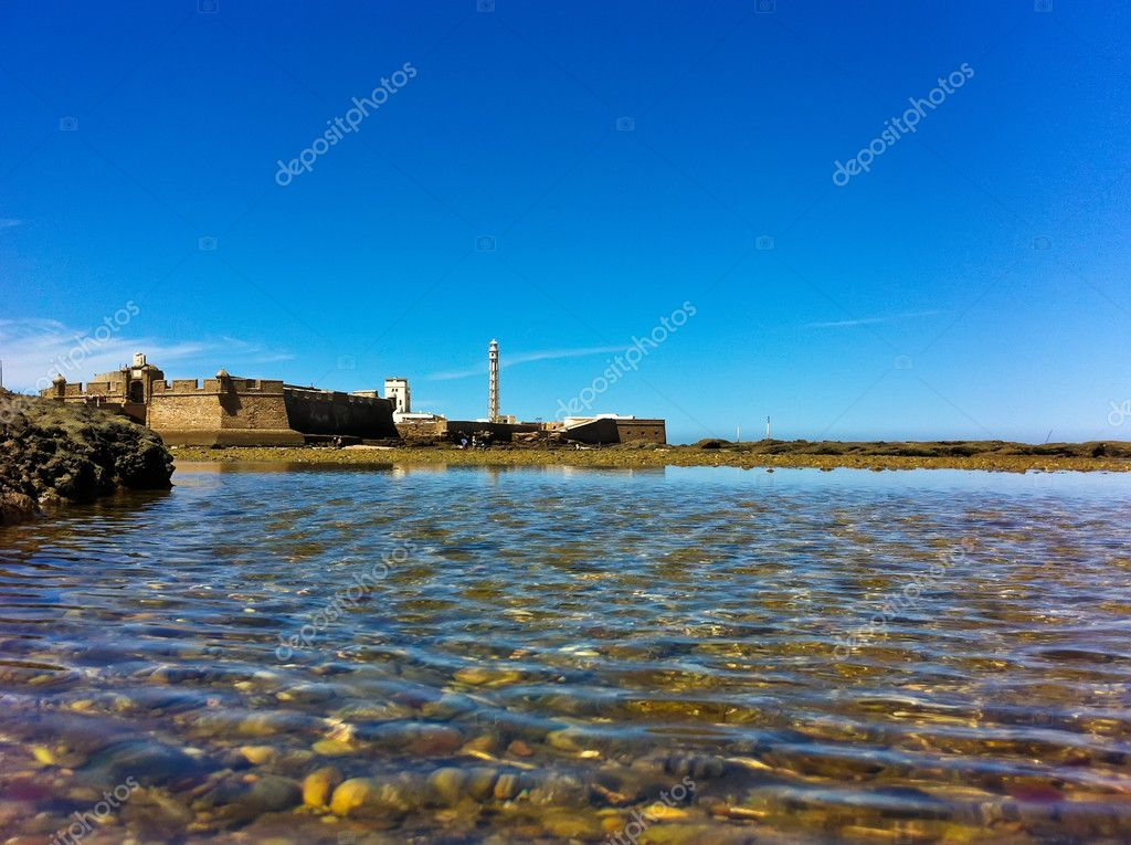 Old castle and lighthouse in cadiz spain — Stock Photo #12047221