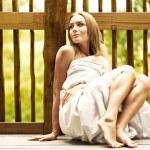 Young woman enjoying spa hotel resort — Stock Photo