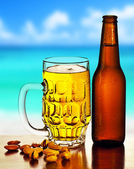 Cold beer on the beach — Stock Photo