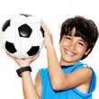 Cute boy playing football - Stockfoto