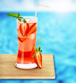 Strawberry juice on the poolside — Stock Photo